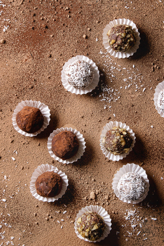 Homemade chocolate truffles in a gold box for gift-giving
