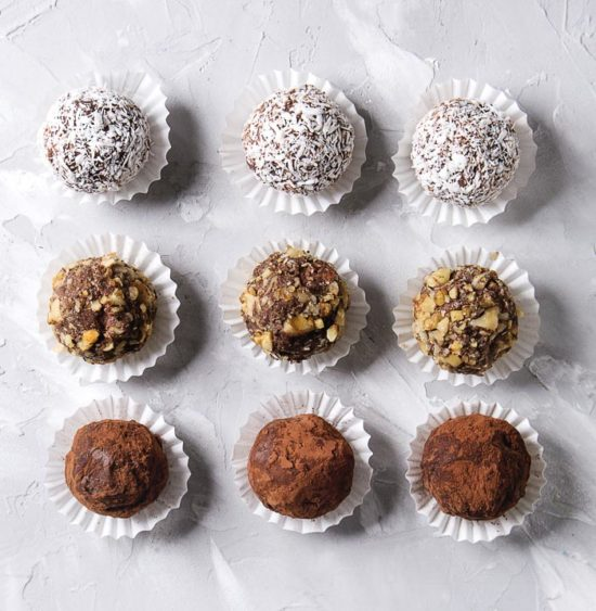 Homemade chocolate truffles in white paper candy cups for gift-giving