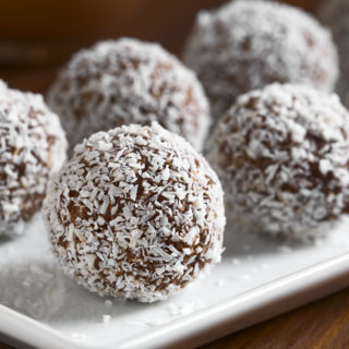 coconut rum balls on a white plate