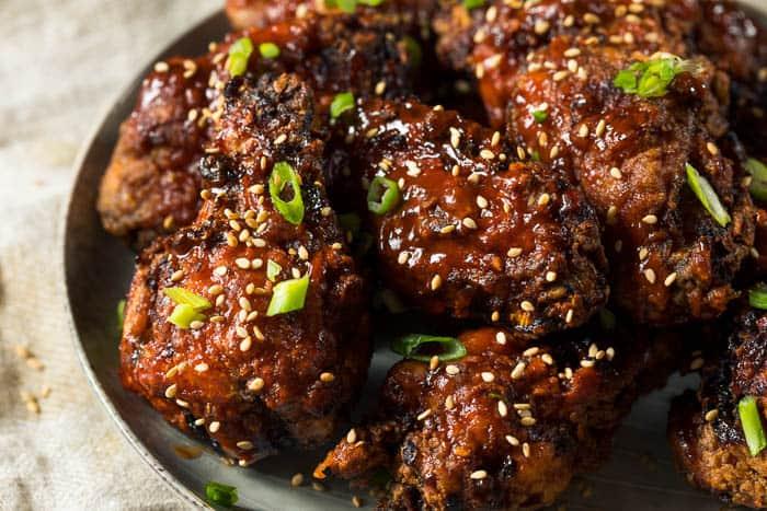 A closeup of a platter of korean chicken wings