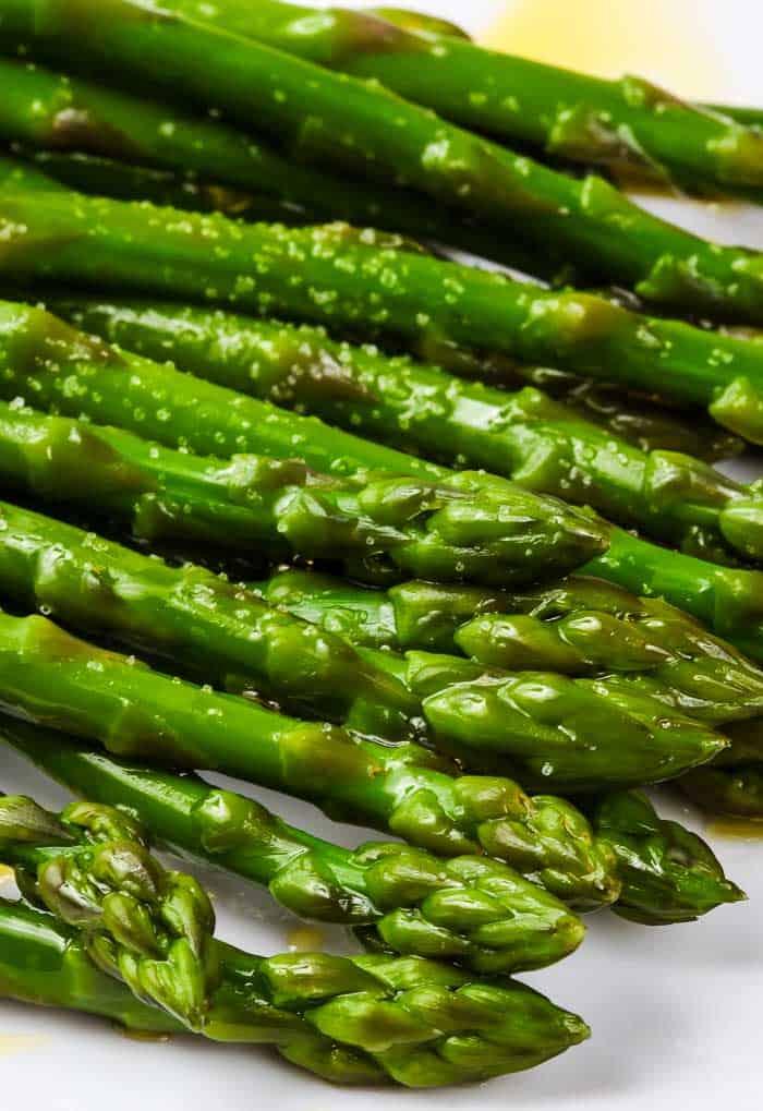 a closeup of oven roasted asparagus