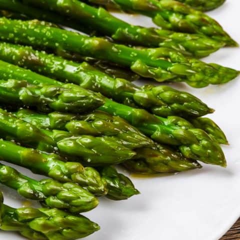 a closeup of the tips from oven-roasted asparagus