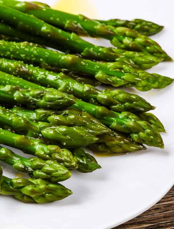a closeup of the tips from oven roasted asparagus