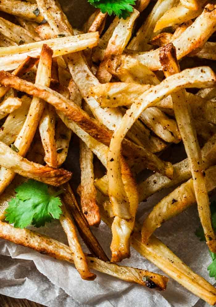 A closeup of baked parsnip fries