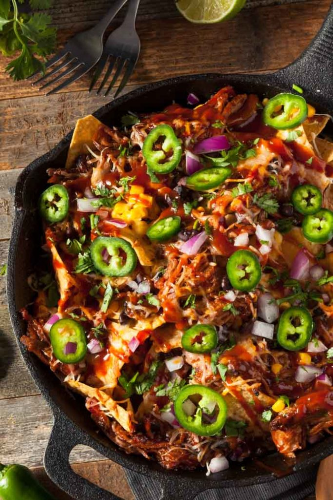 Pulled pork nachos in a cast iron skillet