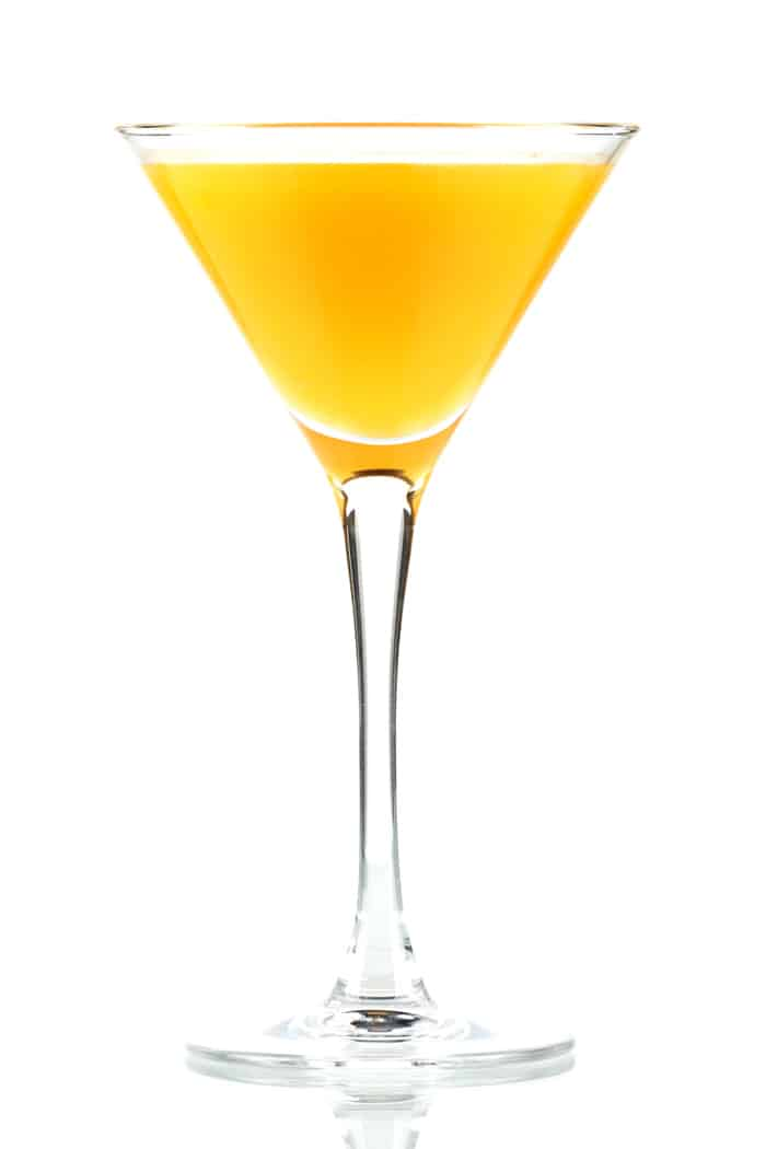 a passion fruit martini on a white background