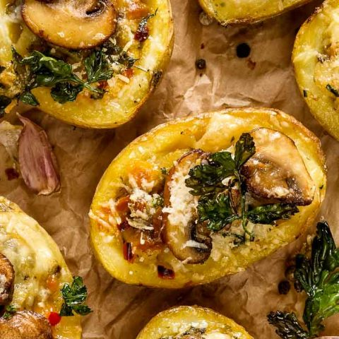 Stuffed Baked Potatoes on parchment paper