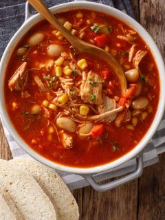 a pot of easy an brunswick stew recipe on striped towel