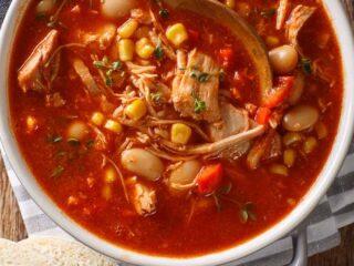 a pot of easy an brunswick stew recipe on striped towel