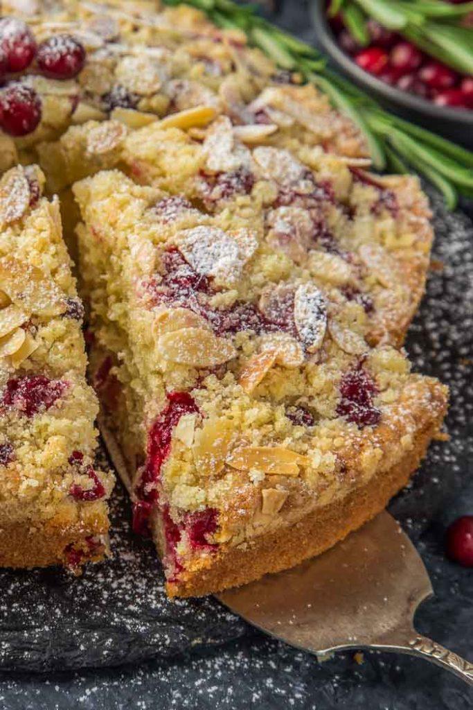 a closeup of a slice of cranberry christmas cake