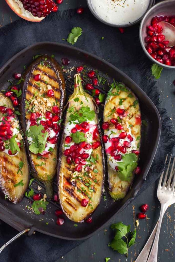 grilled eggplant topped with garlic yogurt sauce, walnuts and pomegranate