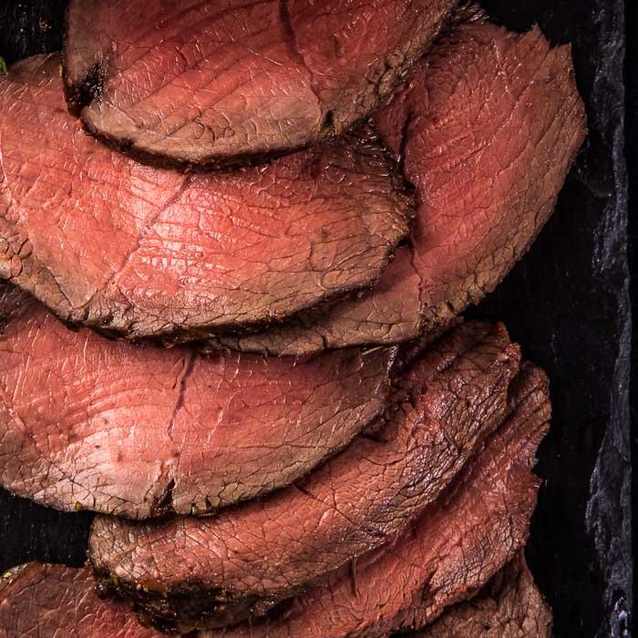 a closeup of sliced roast beef
