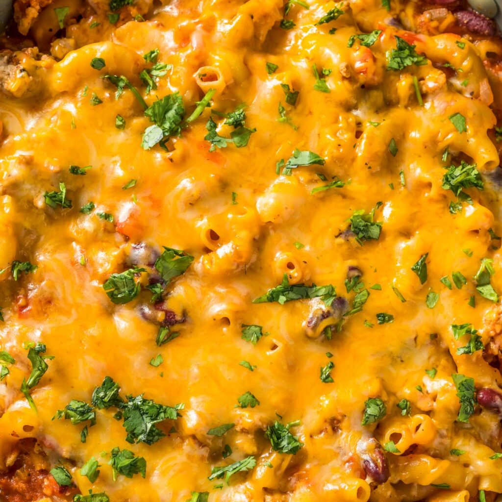 a closeup of a pan of chili mac and cheese