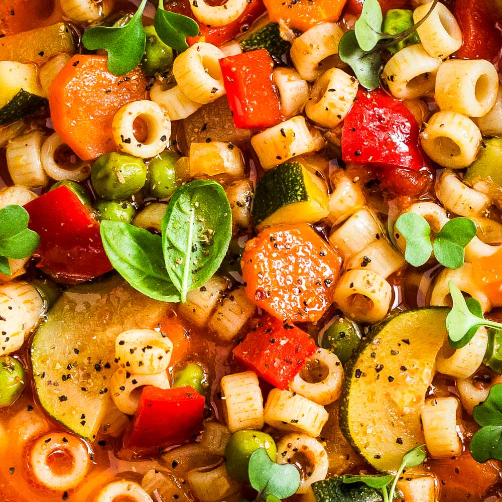 an extreme closeup shot of italian minestrone soup