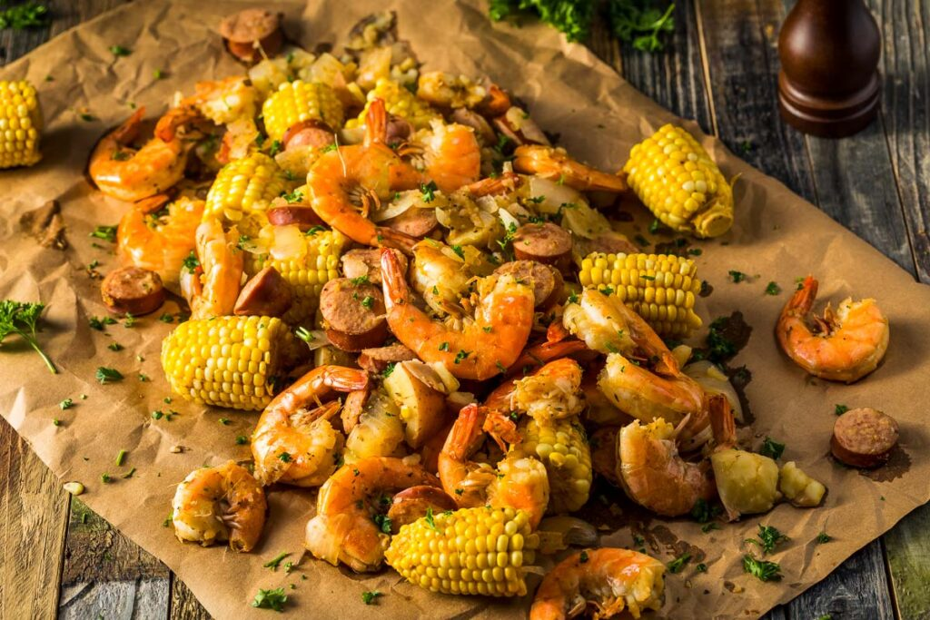 shrimp and sausage boil on brown parchment paper from overhead
