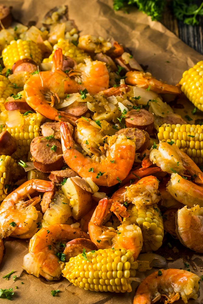a closeup photo of shrimp and sausage boil