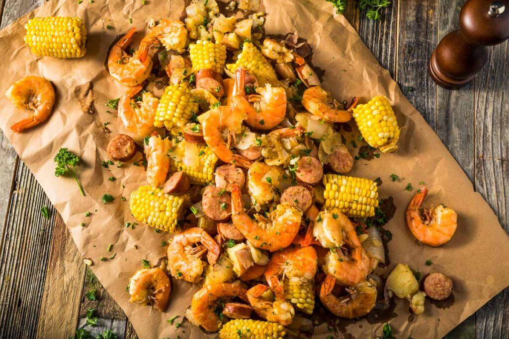 shrimp and sausage boil on brown parchment paper