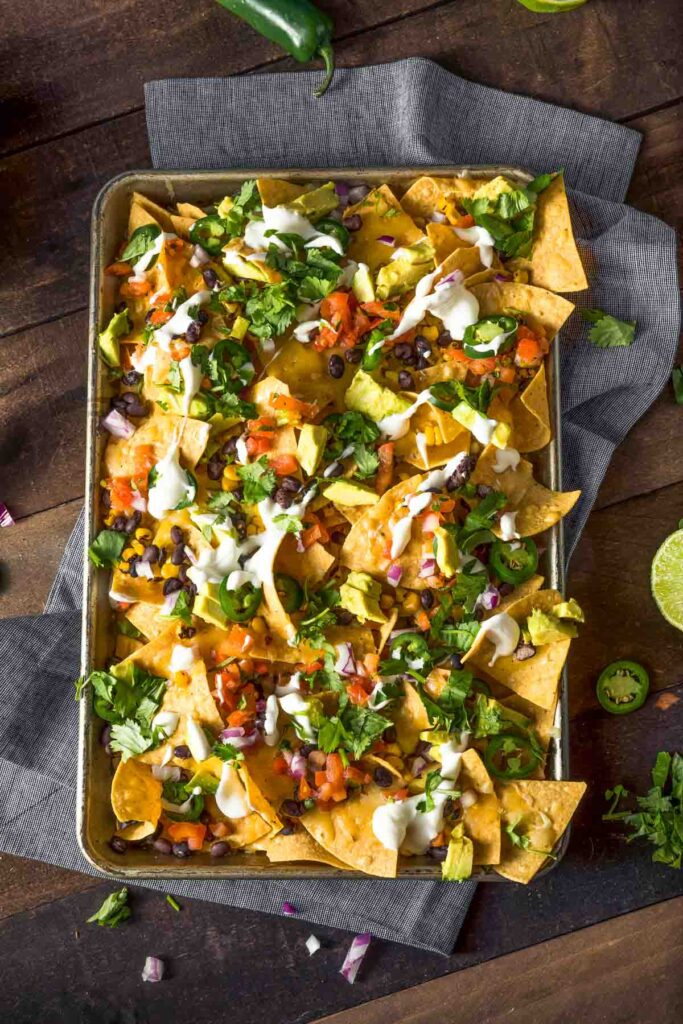 a sheet pan of mexican nachos just out of the oven