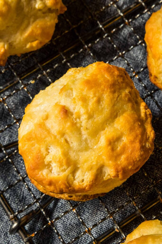 a keto biscuit made with almond flour cooling on a wire rack