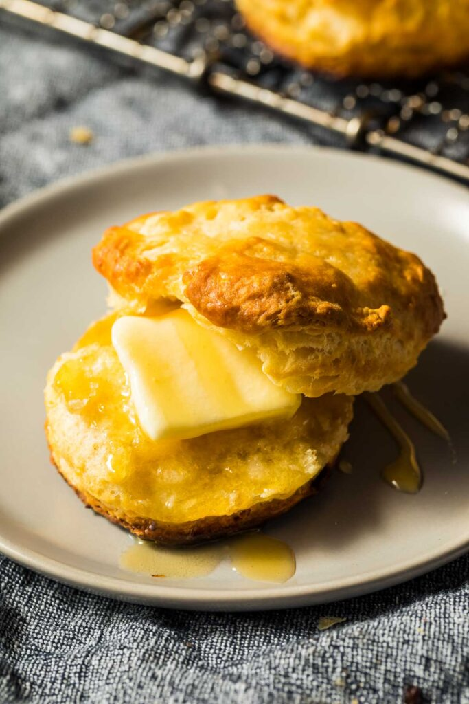 a keto almond flour biscuit spread with butter