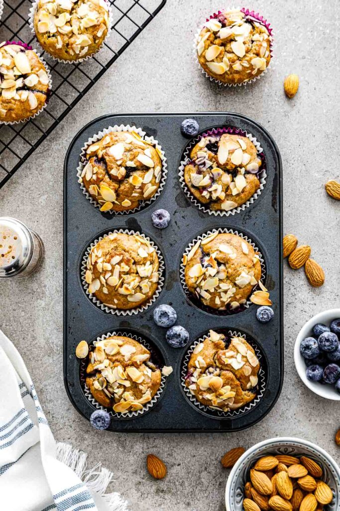 banana blueberry oatmeal muffins in a muffin pan just out of the oven