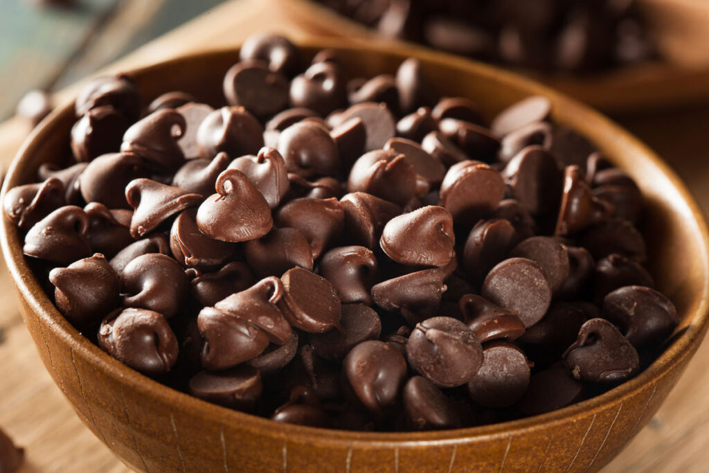 a bowl of chocolate chips ready to be used for pancake toppings