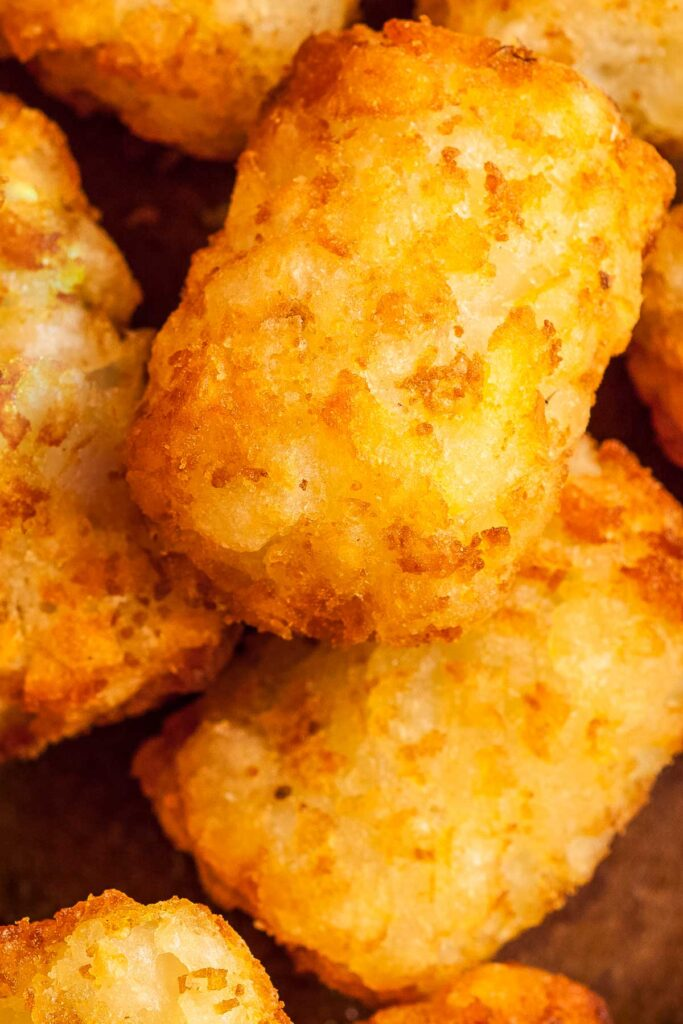 a closeup of tater tots made in the air fryer