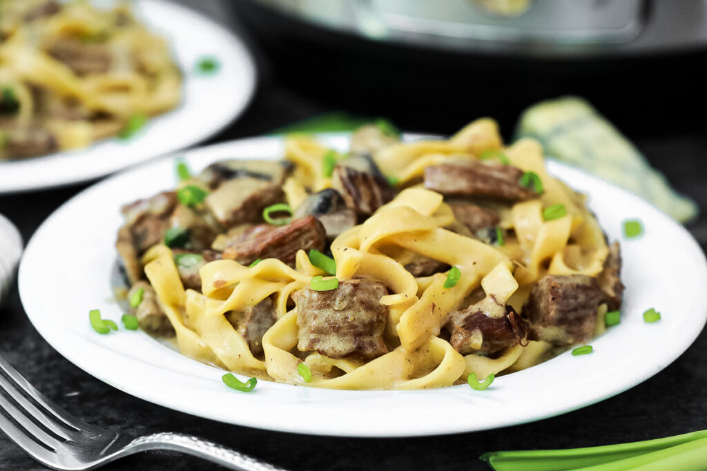 a plate of Instant Pot beef stroganoff with blue cheese and chives